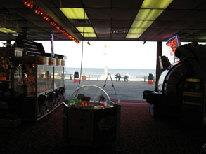 a view of the ocean from an arcade